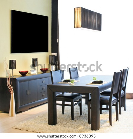 Modern dinning room with black table and closet - stock photo