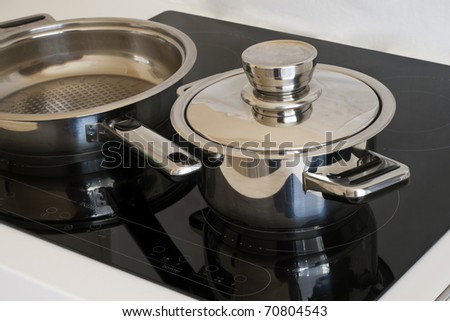 Modern dishes, induction cooker. - stock photo