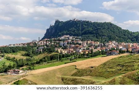 Modern districts of San Marino and Italian suburban hills - stock photo