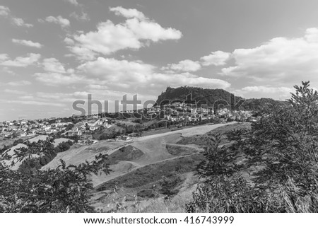 Modern districts of San Marino and Italian suburban hills . Black and white photography.