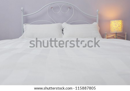 modern double bedroom in a hotel. - stock photo