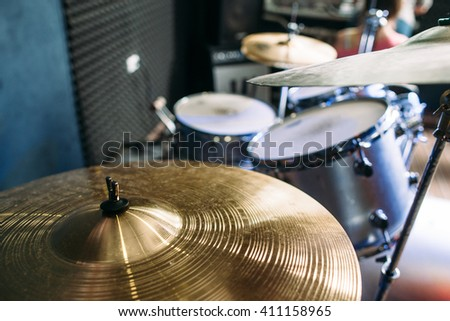 Modern drum set prepared for playing background top view. Flat lay professional drum kit  before a live concert. Drummer, music band, night show, sound recording concept - stock photo