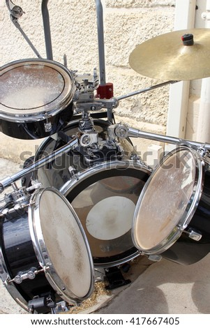 Modern drum set prepared for playing,  Drummer, music band, night show, sound recording concept - stock photo