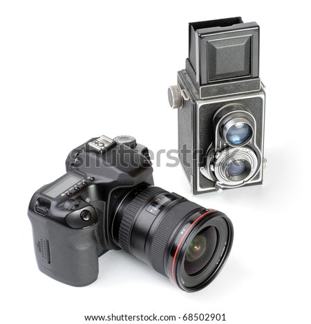 Modern dslr camera and vintage medium format two-lens camera. Picture of evolution in photographic technology. - stock photo