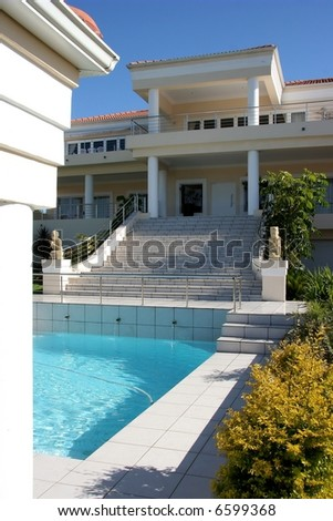 Modern dwelling with swimming pool and huge stairway with pillars