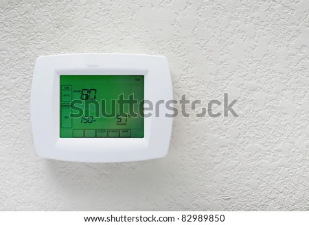 Modern efficient programming thermostat-energy save solution - stock photo