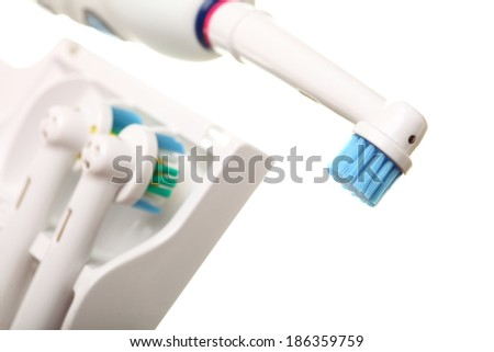 modern electrical toothbrush isolated on white background