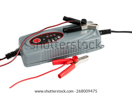 Modern electronic charger for car battery with clamps and jumper cables isolated on white background - stock photo