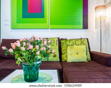 Modern elegance living room with geometric green toned painting - stock photo