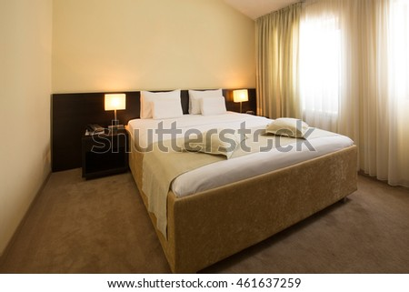 Modern elegant hotel bedroom interior