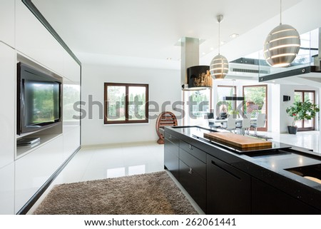 Modern elegant kitchen with home movie theater - stock photo