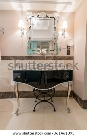 Modern elegant sink in bathroom - stock photo