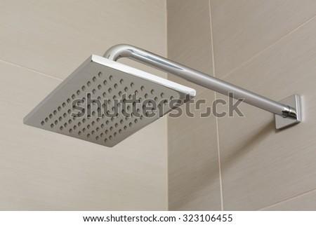 Modern elegant stainless steel shower head - stock photo