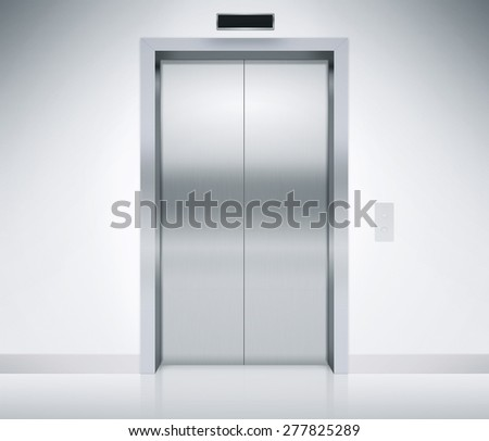 Modern elevator or lift doors made of metal closed in building with lighting. - stock photo