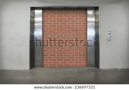 Modern elevator with orange brick - stock photo