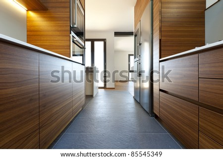Modern empty apartment, view of the kitchen - stock photo