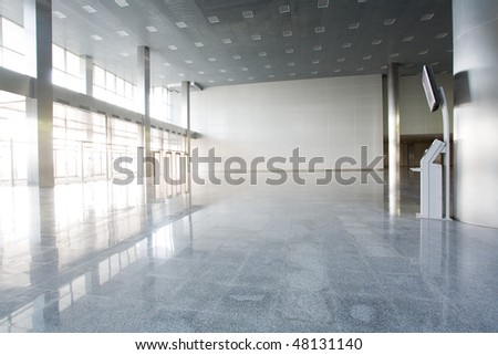 Modern empty building with informational terminal - stock photo