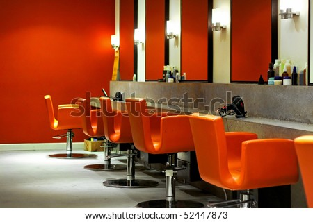 Modern empty hair saloon with chairs and mirrors - stock photo