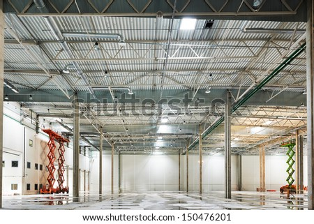 modern empty storehouse under construction - stock photo