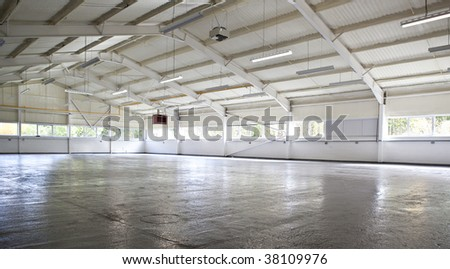 Modern empty warehouse - stock photo