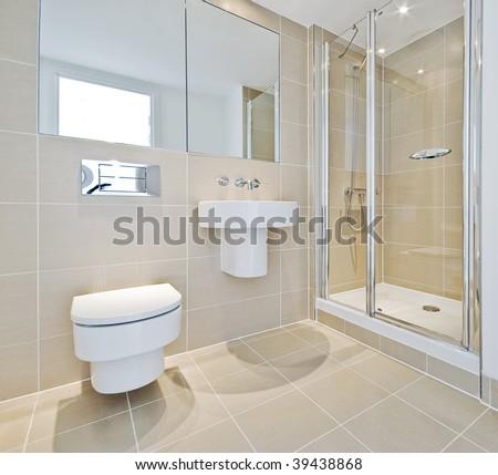 modern en suite bathroom with shower corner - stock photo