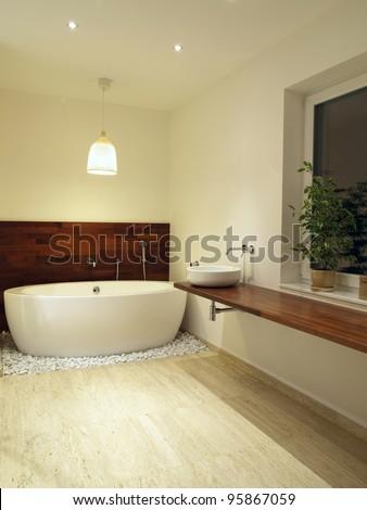 Modern en suite bathroom with travertine tiles - stock photo