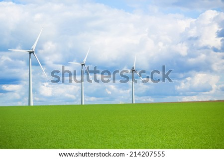 Modern energy wind mill for renewable power generation, ecological awareness concept - stock photo