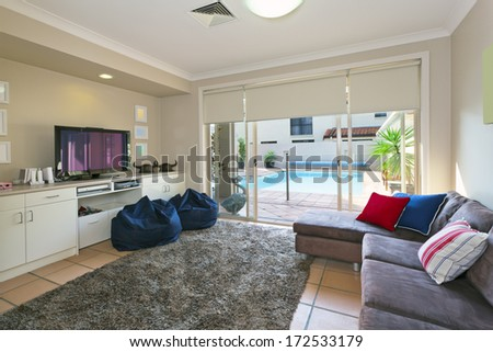 modern entertainment room which opens up to the backyard - stock photo