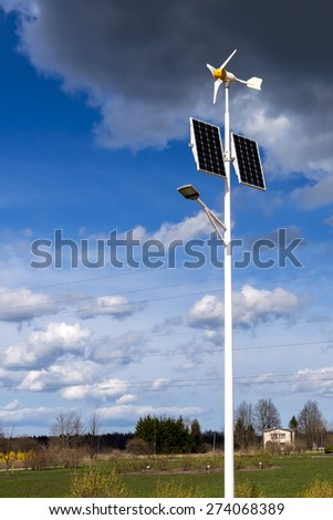 Modern environmentally user-friendly wind electro-turbines in countryside - stock photo