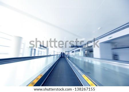 modern escalator at a international airport - stock photo
