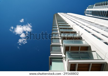 Modern executive flats and office building in Canary Wharf, London. - stock photo