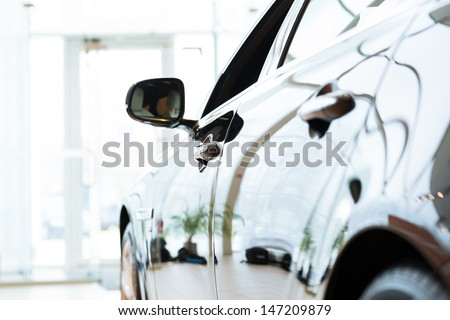 Modern expensive black car in the showroom - stock photo