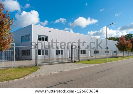 Modern exterior industrial building surrounded by stock for Factory exterior design
