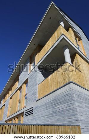 modern facade and blue sky - stock photo