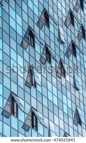 Modern facade of glass and steel with open window with a sinlight reflecting on it/ Abstractions/Buisness buildings