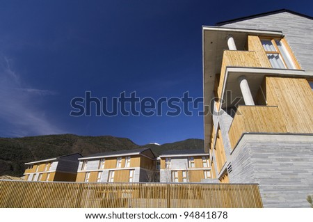 modern facade with blue and clear sky - stock photo