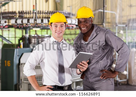 modern factory manager and worker with tablet computer - stock photo