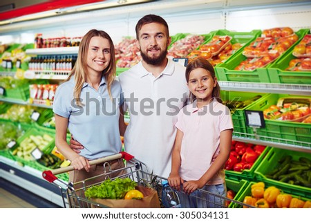 Modern family buying food in supermarket
