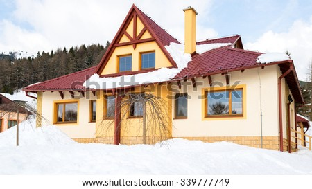 Modern family house covered in snow, ski resort Donovaly, Slovakia