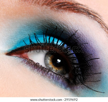 Modern fashion blue makeup of a female eye - macro shot - stock photo