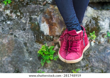 Modern fashionable boots on child's feet