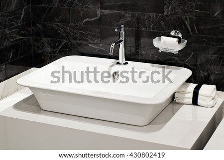 Modern faucet and sink in the bathroom - stock photo