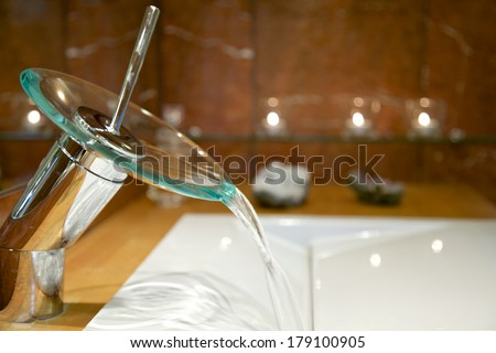 Modern faucet with running water
