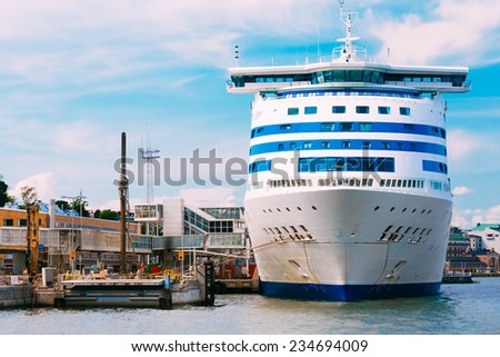 Modern ferry boat at pier awaiting loading cargo from port and passenger boarding and from terminal - stock photo