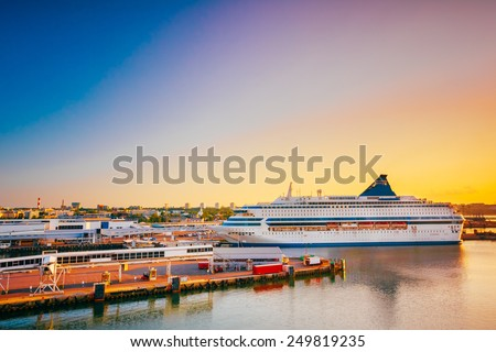 Modern Ferry Boat At Pier Awaiting Loading Cargo From Port And Passenger Boarding And From Terminal. Early Morning With Beautiful Sunrise Sky, Summer Time. - stock photo