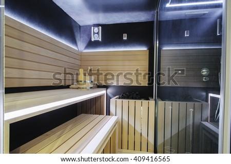 Modern Finnish sauna with neon lights. Beautiful  interior home finnish sauna room.  - stock photo