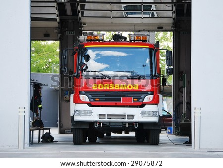 Modern fire truck ready to act in an emergency. Security concept - stock photo
