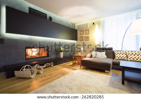 Modern fireplace in cozy luxury drawing room - stock photo