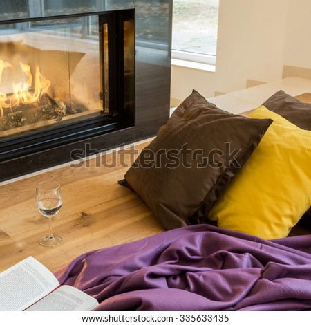 Modern fireplace in the huge house - stock photo
