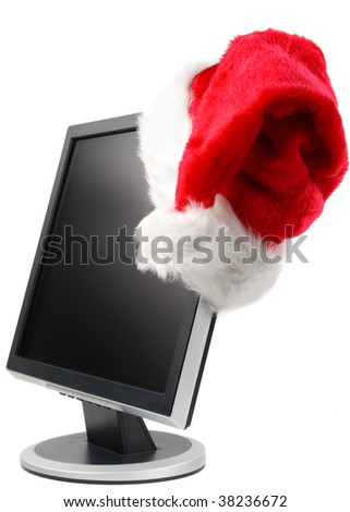 Modern flat screen LCD monitor in a Santa's cap on a white background. - stock photo